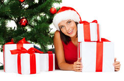 Smiling woman in santa helper hat with gift boxes Stock Photos