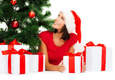 Smiling woman in santa helper hat with gift boxes Royalty Free Stock Photography