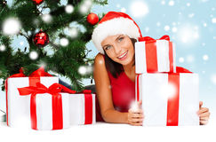 Smiling woman in santa helper hat with gift boxes Royalty Free Stock Photo