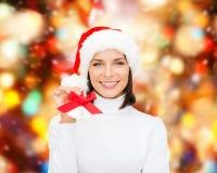 Smiling woman in santa helper hat and jingle bells Stock Photos