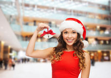 Smiling woman in santa helper hat and jingle bells Royalty Free Stock Photos