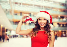 Smiling woman in santa helper hat and jingle bells Stock Photography