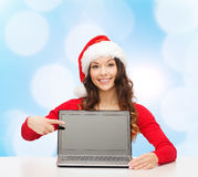 Smiling woman in santa helper hat with laptop Stock Photo
