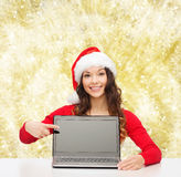 Smiling woman in santa helper hat with laptop Royalty Free Stock Photography