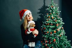 Smiling woman in santa helper hat with many gift boxes. Christmas, x-mas, winter, happiness concept - smiling woman in santa helper hat with many gift boxes Stock Photos