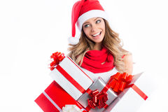 Smiling woman in santa helper hat with many gift boxes. Royalty Free Stock Image