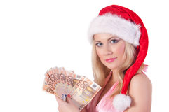 Smiling woman in santa helper hat with  money Stock Photography