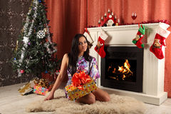 Smiling woman in santa helper hat over living room with christmas tree background Stock Photography