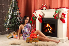 Smiling woman in santa helper hat over living room with christmas tree background Stock Image