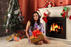 Smiling woman in santa helper hat over living room with christmas tree background Royalty Free Stock Image
