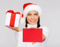 Smiling woman in santa helper hat with postcard Royalty Free Stock Photography