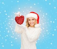 Smiling woman in santa helper hat with red heart Stock Photos
