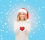Smiling woman in santa helper hat with red heart Stock Image