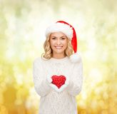 Smiling woman in santa helper hat with red heart Royalty Free Stock Image
