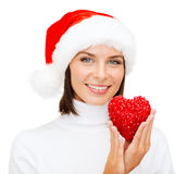 Smiling woman in santa helper hat with red heart Royalty Free Stock Photo