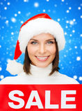 Smiling woman in santa helper hat with sale sign Royalty Free Stock Photography