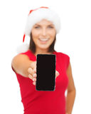 Smiling woman in santa helper hat with smartphone. Christmas, x-mas, electronics and gadget concept - smiling woman in santa helper hat with blank screen Royalty Free Stock Images