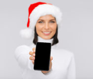 Smiling woman in santa helper hat with smartphone Stock Image