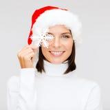 Smiling woman in santa helper hat with snowflake Stock Image