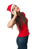 Smiling woman in santa helper hat speaks by phone Stock Photos