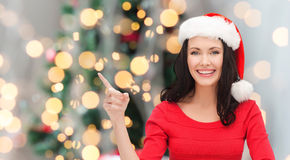 Smiling woman in santa helper hat Royalty Free Stock Photography