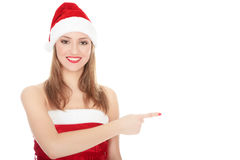 Smiling woman in Santa red hat Royalty Free Stock Photos