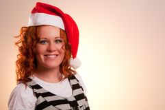 Smiling woman in santa's hat Stock Image