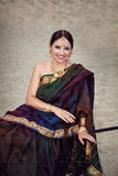 Smiling woman in sari with oriental makeup and jewelry Royalty Free Stock Images