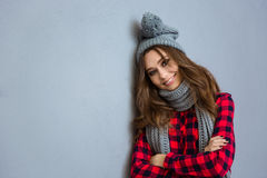 Smiling woman with scarf and hat Royalty Free Stock Photos