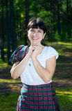 Smiling woman in scottish costume Stock Images