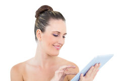 Smiling woman scrolling on her tablet Stock Image