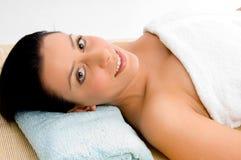 Smiling woman scrubbing her body Stock Photo