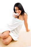 Smiling woman scrubbing her body Royalty Free Stock Photos