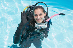 Smiling woman on scuba training in swimming pool making ok sign Royalty Free Stock Photography