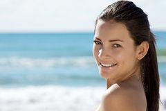 Smiling woman by sea Stock Image