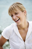 Smiling woman by the sea Stock Photography