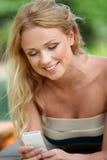 Smiling woman sending message Stock Photos