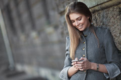 Smiling woman sending sms Stock Photo