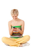 Smiling woman sending sms Stock Image