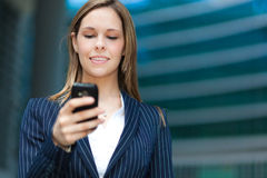 Smiling woman sending a sms Royalty Free Stock Photo