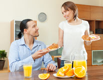 Smiling woman serves breakfast her  man Stock Image
