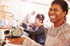 Smiling woman sewing at a community workshop, South Africa Royalty Free Stock Image