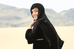 Smiling woman in shawl Royalty Free Stock Image