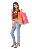 Smiling woman with shopping bags Stock Photos