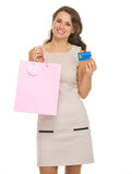 Smiling woman with shopping bags and credit card Royalty Free Stock Photo