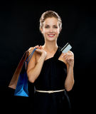 Smiling woman with shopping bags and credit card Stock Photography