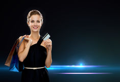 Smiling woman with shopping bags and credit card Royalty Free Stock Image