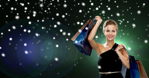 Smiling woman with shopping bags Stock Image