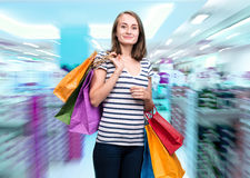 Smiling woman with shopping bags Stock Images