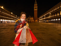 Smiling woman with shopping bags on Piazza San Marco in Venice Stock Image
